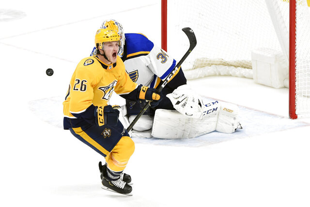Nashville Predators left wing Daniel Carr (26) celebrates after scoring the winning goal past St. Louis Blues goaltender Jake Allen (34) during a shootout in an NHL hockey game Monday, Nov. 25, 2019, in Nashville, Tenn. The Predators won 3-2. (AP Photo/Mark Zaleski)