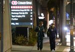 Cedars-Sinai Medical Center workers walk outside the hospital, late Tuesday, Jan. 5, 2021, in Los Angeles. Music producer and hip hop legend Dr. Dre is hospitalized in the intensive care unit at Cedars-Sinai after suffering a brain aneurysm Monday. (AP Photo/Chris Pizzello)