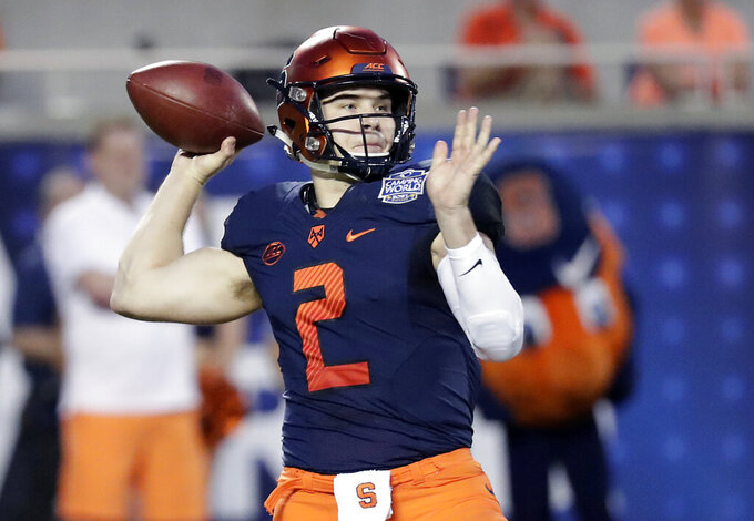 FILE - In this Dec. 28, 2018, file photo, Syracuse quarterback Eric Dungey throws a pass against West Virginia during the first half of the Camping World Bowl NCAA college football game in Orlando, Fla. Still hoping to get a chance at playing professionally, Dungey has been invited to Cincinnati Bengals minicamp. (AP Photo/John Raoux, File)