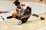 Alabama guard Joshua Primo (11) and Western Kentucky guard Jordan Rawls (3) battle for a loose ball during the second half of an NCAA college basketball game, Saturday, Dec. 19, 2020, in Tuscaloosa, Ala. (AP Photo/Vasha Hunt)