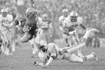 FILE - In this Jan. 20, 1985, file photo, San Francisco 49ers Roger Craig (33) goes airborne as he crosses goal line for a touchdown during the second quarter of NFL Super Bowl XIX football game against the Miami Dolphins in Stanford, Calif.  NFL champion players Roger Craig, Drew Pearson and Donnie Shell are among the finalists for the Pro Football Hall of Fame's special centennial class announced Thursday, Dec. 19, 2019. A 25-member panel of pro football experts is charged with selecting 10 senior players, two coaches and three contributors who will be inducted into the Canton, Ohio shrine next year as part of the league's celebration of its 100th season. (AP Photo/File)