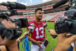 Alabama quarterback Tua Tagovailoa (13) talks with the media prior to Alabama's fall camp fan-day college football scrimmage, Saturday, Aug. 3, 2019, at Bryant-Denny Stadium in Tuscaloosa, Ala. (AP Photo/Vasha Hunt)
