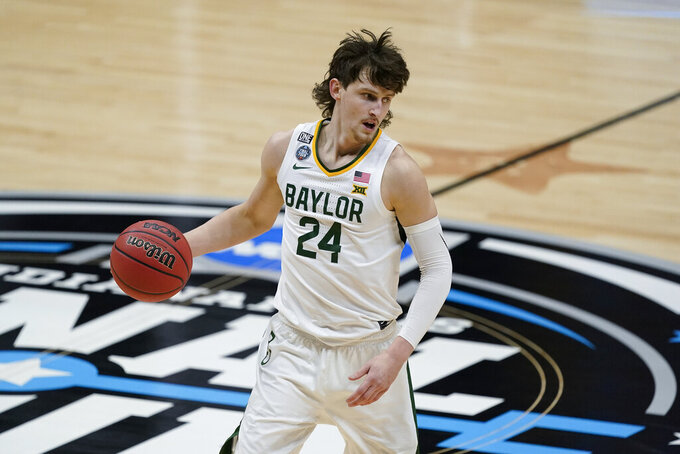 Baylor guard Matthew Mayer (24) drives up court during the second half of a men's Final Four NCAA college basketball tournament semifinal game against Houston, Saturday, April 3, 2021, at Lucas Oil Stadium in Indianapolis. (AP Photo/Darron Cummings)