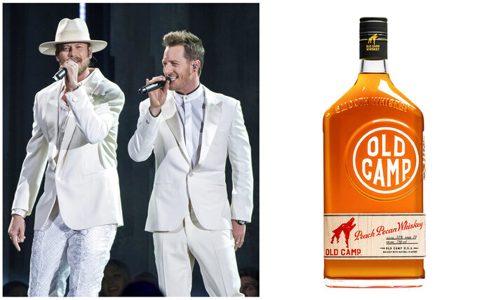 This combination photo shows Brian Kelley, left, and Tyler Hubbard of Florida Georgia Line performing at the 52nd annual CMA Awards in Nashville, Tenn. on Nov. 14, 2018, left, and a bottle of their Old Camp peach pecan whiskey. Celebrities are deep into the liquor and wine business with their own brands that are particularly gifty for drink-loving fans. (AP Photo, left, and Old Camp Whiskey)