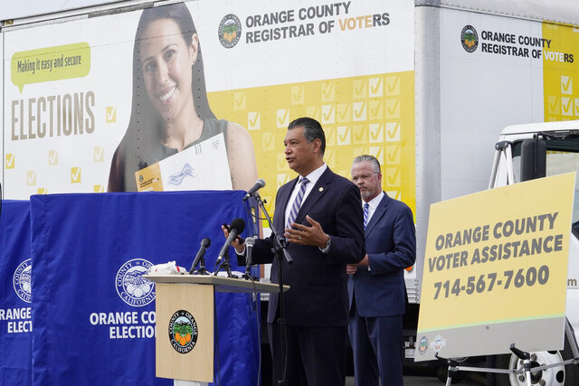 FILE - In this Oct. 5, 2020, file photo, California Secretary of State Alex Padilla, left, and Orange County Registrar of Voters Neal Kelley hold a news conference on Orange County's comprehensive plans to safeguard the election and provide transparency in Santa Ana, Calif. California election officials have received reports that unofficial ballot drop boxes were placed in several counties and said these set-ups are illegal. The Orange County Register reports Monday, Oct. 12, 2020, that Secretary of State spokesman Sam Mahood said boxes were reported in Fresno, Los Angeles and Orange counties at locations including political party offices, candidate headquarters and churches. He said the state was looking into the origin of the boxes. (AP Photo/Damian Dovarganes, File)