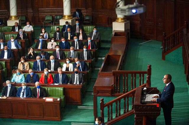 Tunisian designated Prime Minister Hichem Mechichi, right, delivers his speech at the parliament before a confidence vote in Tunis, Tuesday, Sept. 1, 2020. (AP Photo/Riadh Dridi)