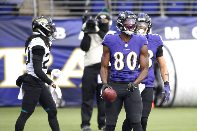 Baltimore Ravens wide receiver Miles Boykin (80) reacts after scoring on a touchdown pass from quarterback Lamar Jackson, not visible, during the first half of an NFL football game against the Jacksonville Jaguars, Sunday, Dec. 20, 2020, in Baltimore. (AP Photo/Nick Wass)