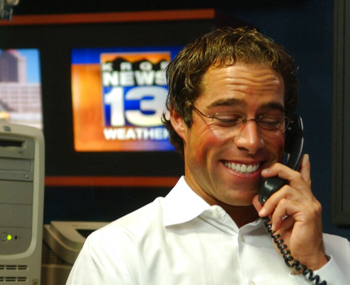 In this Oct. 5, 2006 photo, KRQE-TV Chief Meteorologist Mark Ronchetti prepares the weathercast by analyzing numbers and designing maps at the KRQE studios in Albuquerque, N.M. Ronchetti announced Tuesday, Jan. 7, 2020, that he is joining the race for U.S. Senate in New Mexico. Ronchetti is jumping in the contest for the GOP nomination after stepping down for his job as chief meteorologist for the CBS affiliate in Albuquerque. (Jaelyn deMaria/The Albuquerque Journal via AP)
