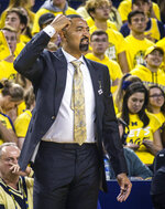 Michigan head coach Juwan Howard signals to his players on the court in the first half of an NCAA college basketball game against Creighton at Crisler Center in Ann Arbor, Mich., Tuesday, Nov. 12, 2019. Michigan won 79-69. (AP Photo/Tony Ding)
