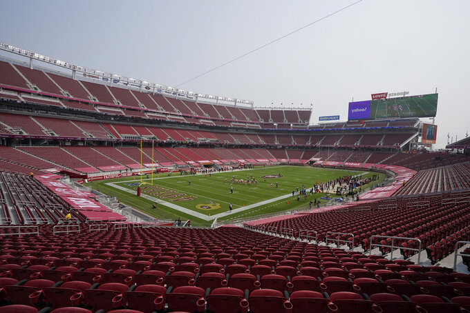 Empty seats are shown at Levi's Stadium during the first half of an NFL football game between the San Francisco 49ers and the Arizona Cardinals in Santa Clara, Calif., Sunday, Sept. 13, 2020. (AP Photo/Jeff Chiu)