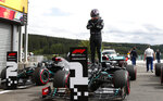 Mercedes driver Lewis Hamilton of Britain stands on his car after setting the fastest time during the qualifying session prior to the Formula One Grand Prix at the Spa-Francorchamps racetrack in Spa, Belgium Saturday, Aug. 29, 2020. Hamilton will start in pole position for race on Sunday. (Francois Lenoir, Pool via AP)