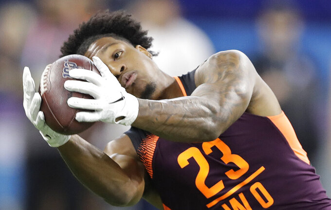 FILE - In this March 2, 2019, file photo, Arizona State wide receiver N'Keal Harry runs a drill during the NFL football scouting combine, in Indianapolis. Harry is a possible pick in the 2019 NFL Draft. (AP Photo/Darron Cummings, File)