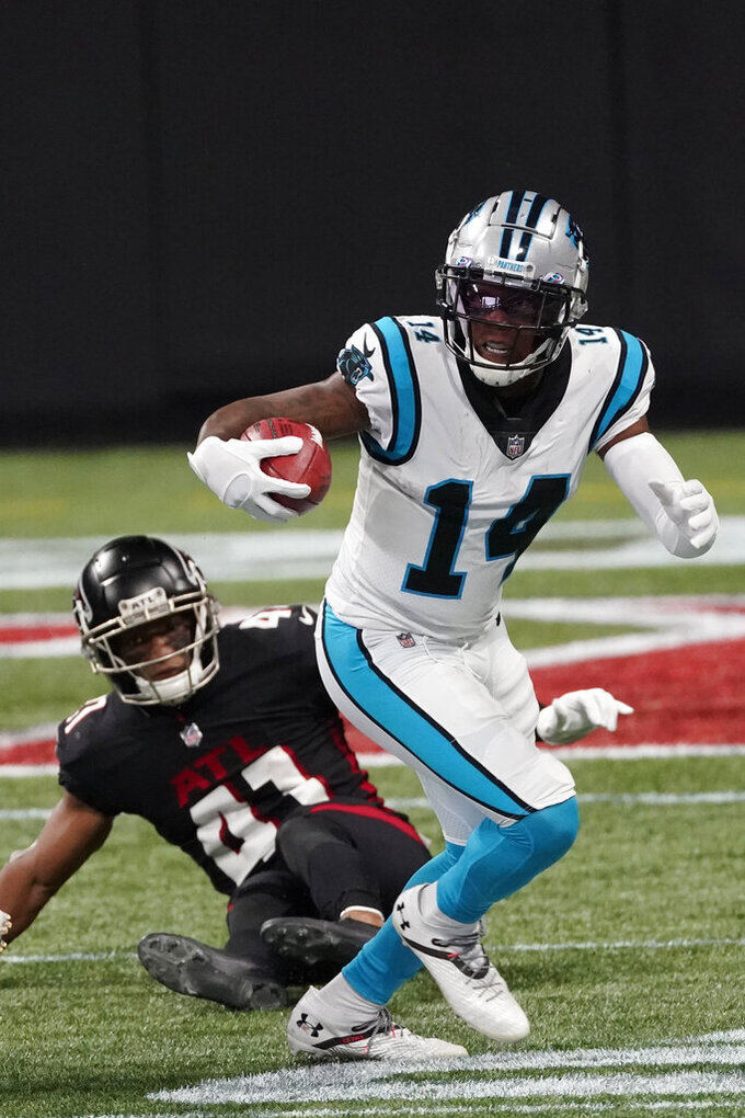 Carolina Panthers wide receiver Pharoh Cooper (14) runs against Atlanta Falcons safety Sharrod Neasman (41) during the first half of an NFL football game, Sunday, Oct. 11, 2020, in Atlanta. (AP Photo/John Bazemore)