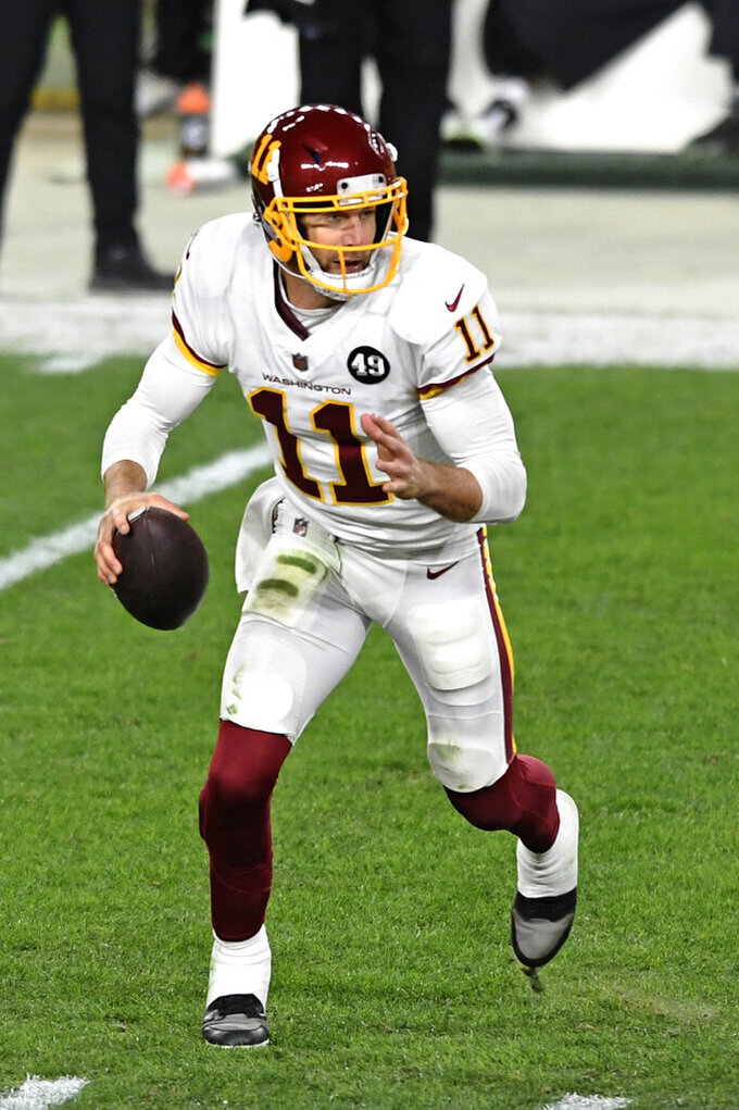 Washington Football Team quarterback Alex Smith (11) looks to pass during the first half of an NFL football game against the Pittsburgh Steelers in Pittsburgh, Monday, Dec. 7, 2020. (AP Photo/Barry Reeger)