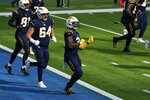 Los Angeles Chargers running back Kalen Ballage, center, reacts after scoring a touchdown during the first half of an NFL football game against the Las Vegas Raiders, Sunday, Nov. 8, 2020, in Inglewood, Calif. (AP Photo/Ashley Landis)