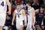 Gonzaga forwards Filip Petrusev (3) and Killian Tillie (33) celebrate after Petrusev scored during the second half of the team's NCAA college basketball game against Saint Mary's in Spokane, Wash., Saturday, Feb. 29, 2020. Gonzaga won 86-76. (AP Photo/Young Kwak)
