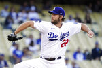 Los Angeles Dodgers starting pitcher Clayton Kershaw throws to the plate during the first inning of a baseball game against the Texas Rangers Friday, June 11, 2021, in Los Angeles. (AP Photo/Mark J. Terrill)
