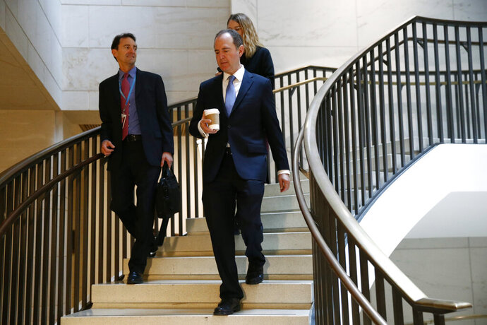 Rep. Adam Schiff, D-Calif., walks to a secure area of the Capitol before the arrival of Catherine Croft, a State Department adviser on Ukraine, who is scheduled to testify in a closed door meeting as part of the House impeachment inquiry into President Donald Trump, Wednesday, Oct. 30, 2019, in Washington. (AP Photo/Patrick Semansky)