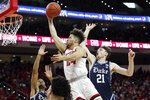 North Carolina State guard Devon Daniels drives to the basket while Duke forward Matthew Hurt (21) and guard Cassius Stanley, left, defend during the first half of an NCAA college basketball game in Raleigh, N.C., Wednesday, Feb. 19, 2020. (AP Photo/Gerry Broome)