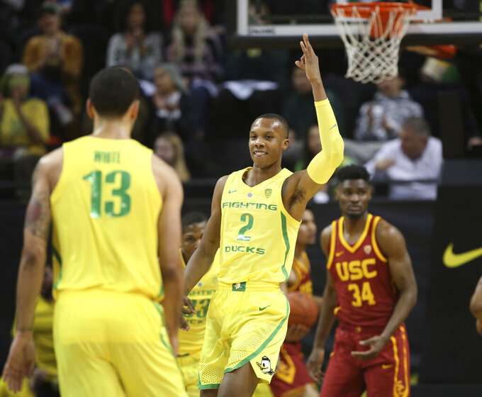 Oregon's Louis King, center, celebrates against Southern California during the first half of an NCAA college basketball game, Sunday, Jan. 13, 2019, in Eugene, Ore. (AP Photo/Chris Pietsch)