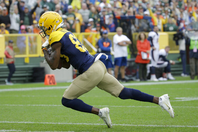 Green Bay Packers wide receiver Marquez Valdes-Scantling catches a touchdown pass during the first half of an NFL football game against the Denver Broncos, Sunday, Sept. 22, 2019, in Green Bay, Wis. (AP Photo/Mike Roemer)