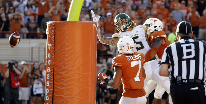 A game-ending, incomplete pass sails over Baylor wide receiver Jalen Hurd (5) during the second half of an NCAA college football game against Texas , Saturday, Oct. 13, 2018, in Austin, Texas. (AP Photo/Eric Gay)