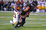 Utah wide receiver Samson Nacua, right, scores against Southern California safety Isaiah Pola-Mao (21) during the first half of an NCAA college football game Saturday, Nov. 21, 2020, in Salt Lake City. (AP Photo/Rick Bowmer)