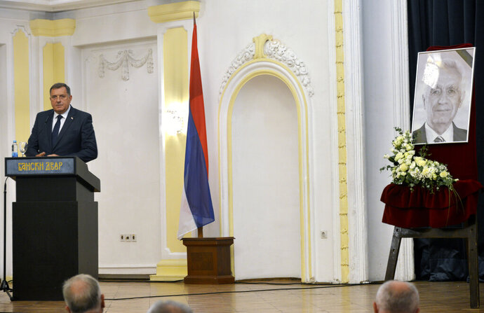Bosnian Serb official, Milorad Dodik, who is the member of Bosnia's multi-ethnic presidency speaks during an official commemoration ceremony for Momcilo Krajisnik, wartime parliament speaker in Banja Luka, Bosnia, Wednesday, Sept. 16, 2020. Bosnian Serb authorities on Wednesday held an official commemoration ceremony for a former wartime top leader who died of COVID-19, despite his war crimes conviction by a U.N. court. Bosnian Serb president, prime minister and other officials attended the ceremony in the northern city of Banja Luka, the seat of the Serb-run part of Bosnia. (AP Photo/Radivoje Pavicic)