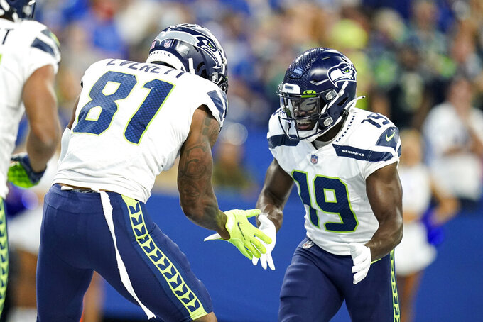 Seattle Seahawks tight end Gerald Everett (81) celebrates a touchdown with wide receiver Penny Hart (19) in the first half of an NFL football game against the Indianapolis Colts in Indianapolis, Sunday, Sept. 12, 2021. (AP Photo/Charlie Neibergall)