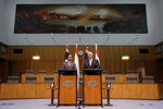 Indonesia's President Joko Widodo, left, and Australia's Prime Minister Scott Morrison give a joint statement at Parliament House in Canberra, Monday, Feb. 10, 2020. Widodo is on a two-day visit to Canberra, his fourth visit to Australia. (AP Photo/Rick Rycroft, Pool)