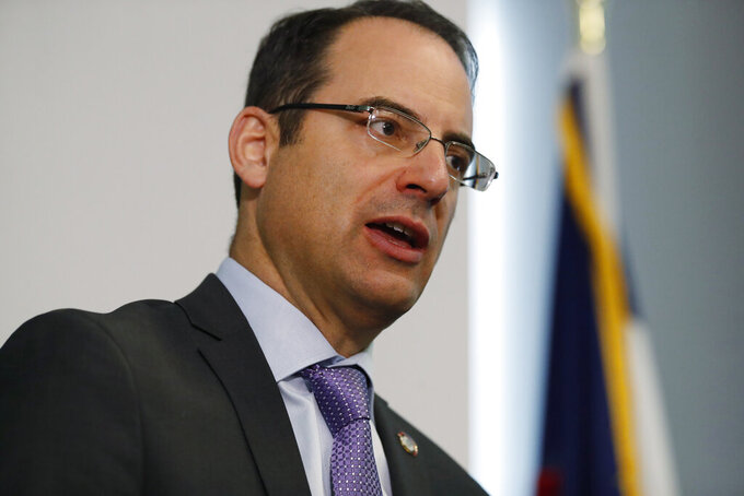 FILE - In this Monday, Oct. 7, 2019, file photo, Colorado Attorney General Phil Weiser speaks during a news conference in Denver. Colorado Attorney General Weiser announced a statewide campaign Thursday, March 4, 2021, to identify and prosecute persons responsible for an estimated 1 million-plus fraudulent claims for unemployment benefits during the coronavirus pandemic. (AP Photo/David Zalubowski, File)