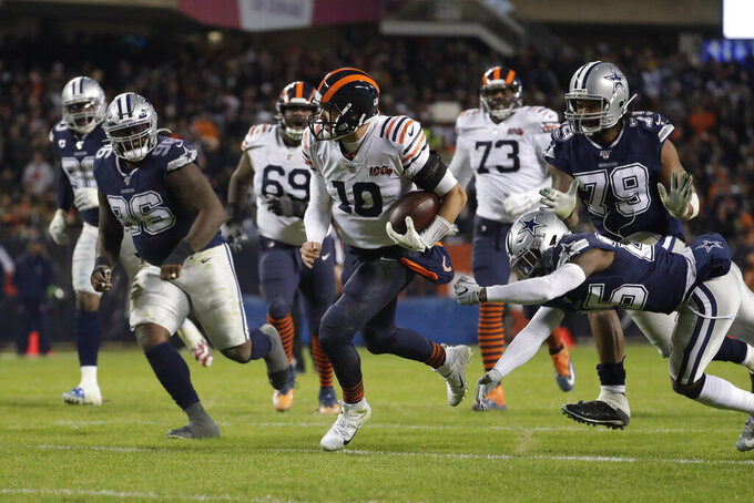 Chicago Bears quarterback Mitchell Trubisky (10) runs for a touchdown during the second half of an NFL football game against the Dallas Cowboys, Thursday, Dec. 5, 2019, in Chicago. (AP Photo/Morry Gash)