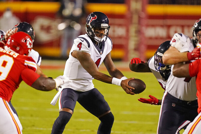 Houston Texans quarterback Deshaun Watson (4) hands the ball off in the first half of an NFL football game against the Kansas City Chiefs Thursday, Sept. 10, 2020, in Kansas City, Mo. (AP Photo/Charlie Riedel)