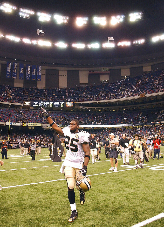 FILE - In this Sept. 25, 2006, file photo, New Orleans Saints running back Reggie Bush (25) reacts at the end of a 23-3 win in their football game against the Atlanta Falcons at the newly re-opened Louisiana Superdome in New Orleans. (AP Photo/Andrew J. Cohoon, File)