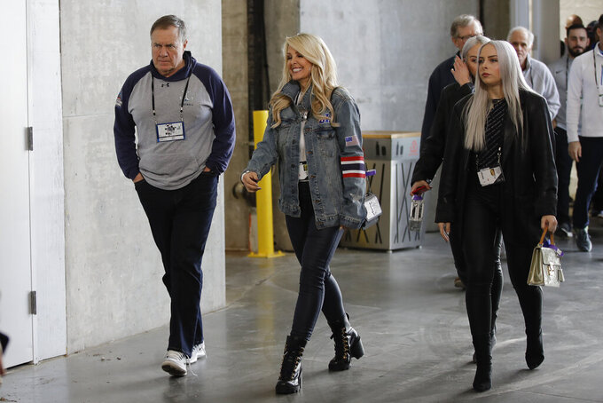 New England Patriots head coach Bill Belichick and Linda Holliday arrive for a NFL football walkthrough, Saturday, Feb. 2, 2019, in Atlanta, ahead of Super Bowl 53 against the Los Angeles Rams. (AP Photo/Matt Rourke)
