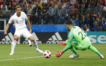 England's Harry Kane, left, plays the ball against the goal post during the semifinal match between Croatia and England at the 2018 soccer World Cup in the Luzhniki Stadium in Moscow, Russia, Wednesday, July 11, 2018. (AP Photo/Alastair Grant)