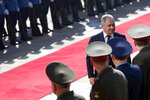 Russian Defense Minister Sergei Shoigu reviews the honour guard during a welcome ceremony in Belgrade, Serbia, Monday, Feb. 17, 2020. Shoigu is on a one-day official visit to Serbia. (AP Photo/Darko Vojinovic)