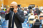 Britain's Health Secretary Sajid Javid speaks to the media during a visit to a pop-up vaccination site at a sports centre in west London, Wednesday July 28, 2021.  The British government has said that starting upcoming Monday Aug. 2, 2021, fully vaccinated travellers from the United States and much of Europe will be able to enter England without the need for quarantining.(Dominic Lipinski/PA via AP)