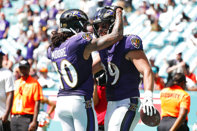 Baltimore Ravens wide receiver Chris Moore (10) congratulates tight end Mark Andrews (89) after Andrews scored a touchdown, during the second half at an NFL football game against the Miami Dolphins, Sunday, Sept. 8, 2019, in Miami Gardens, Fla. (AP Photo/Wilfredo Lee)