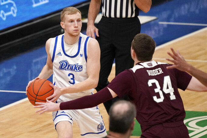 Drake's Garrett Sturtz (3) looks to pass around Missouri State's Jared Ridder (34) during the first half of an NCAA college basketball game in the semifinal round of the Missouri Valley Conference men's tournament Saturday, March 6, 2021, in St. Louis. (AP Photo/Jeff Roberson)