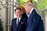 FILE - In this June 1, 2018, file photo, U.S. President Donald Trump, right, talks with Kim Yong Chol, former North Korean military intelligence chief and one of leader Kim Jong Un's closest aides, as they walk from their meeting in the Oval Office of the White House in Washington. North Korea says it won't consider a U.S. decision to postpone a joint military exercise with South Korea a concession in stalled nuclear diplomacy. (AP Photo/Andrew Harnik, File)