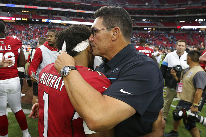 Carolina Panthers head coach Ron Rivera greets Arizona Cardinals quarterback Kyler Murray (1) after an NFL football game, Sunday, Sept. 22, 2019, in Glendale, Ariz. The Panthers won 38-20. (AP Photo/Ross D. Franklin)