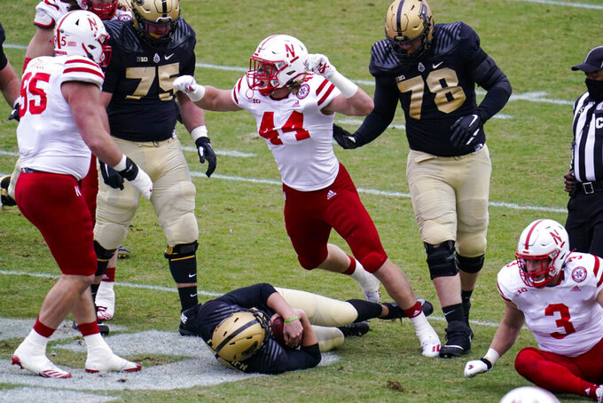 Nebraska linebacker Garrett Nelson (44) celebrates a sack against Purdue during the first quarter of an NCAA college football game in West Lafayette, Ind., Saturday, Dec. 5, 2020. (AP Photo/Michael Conroy)