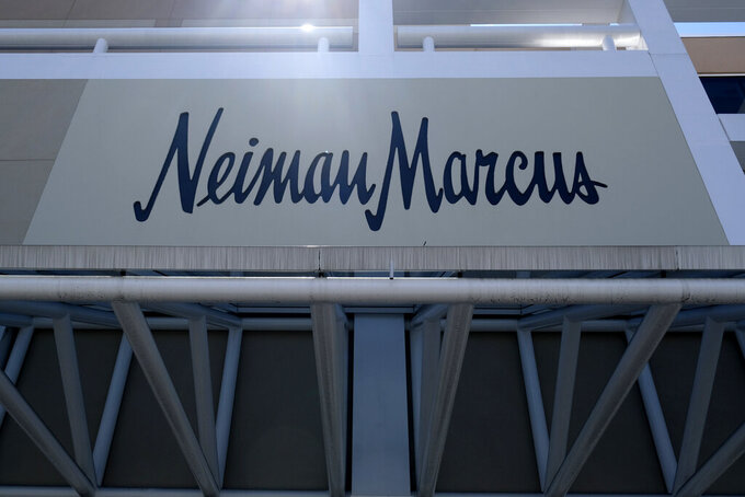 FILE - This May 7, 2020 file photo shows a closed Neiman Marcus store at the Garden State Plaza mall in Paramus, N.J.  Neiman Marcus is hoping to capitalize on rebounding luxury sales by investing more than $500 million over the next three years in refreshing stores, speeding up deliveries and  acquiring new technology. The plan, unveiled Tuesday, June 15, 2021,  includes a pact to  purchase Stylyze Inc., a startup that recommends outfits for customers based on past purchases and browsing history. (AP Photo/Seth Wenig)