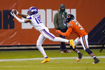 Minnesota Vikings wide receiver Justin Jefferson (18) catches a pass as Chicago Bears cornerback Jaylon Johnson defends during the first half of an NFL football game Monday, Nov. 16, 2020, in Chicago. (AP Photo/Nam Y. Huh)