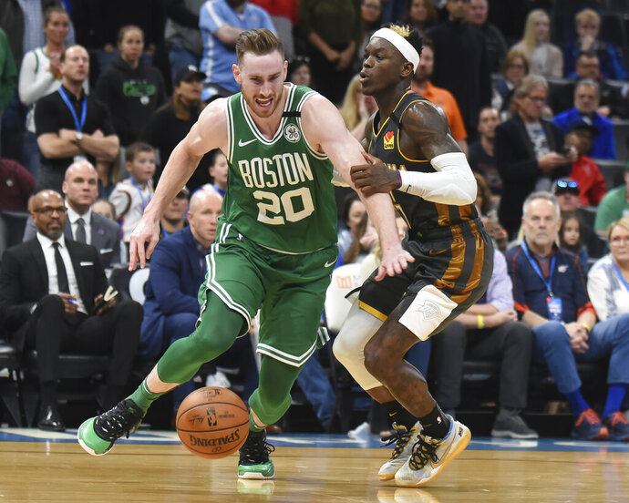 Boston Celtics forward Gordon Hayward (20) pushes past Oklahoma City Thunder guard Dennis Schroder (17) in the second half of an NBA basketball game, Sunday, Feb. 9, 2020, in Oklahoma City. (AP Photo/Kyle Phillips)
