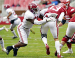 FILE - In this Dec. 12, 2020, file photo, Arkansas quarterback Feleipe Franks (13) is tackled for a loss by Alabama defender Will Anderson Jr. (31) during the first half of an NCAA college football game in Fayetteville, Ark. Anderson was selected to The Associated Press Preseason All-America first team defense, Monday Aug. 23, 2021.(AP Photo/Michael Woods, File)