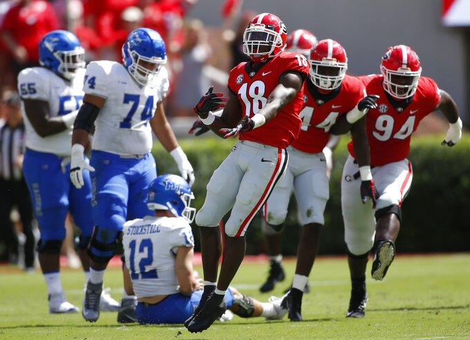 FILE - In this Sept. 15, 2018, file photo, Georgia cornerback Deandre Baker (18) celebrates after making an interception during the first half of the team's NCAA college football game against Middle Tennessee in Athens, Ga. Alabama faces a Georgia secondary led by cornerback Deandre Baker and one of the SEC's top defenses. (Jenn Finch/Athens Banner-Herald via AP, FIle)