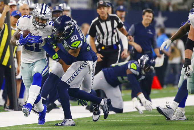 fDallas Cowboys running back Ezekiel Elliott (21) runs against Seattle Seahawks strong safety Bradley McDougald (30) irst half of the NFC wild-card NFL football game in Arlington, Texas, Saturday, Jan. 5, 2019. (AP Photo/Ron Jenkins)