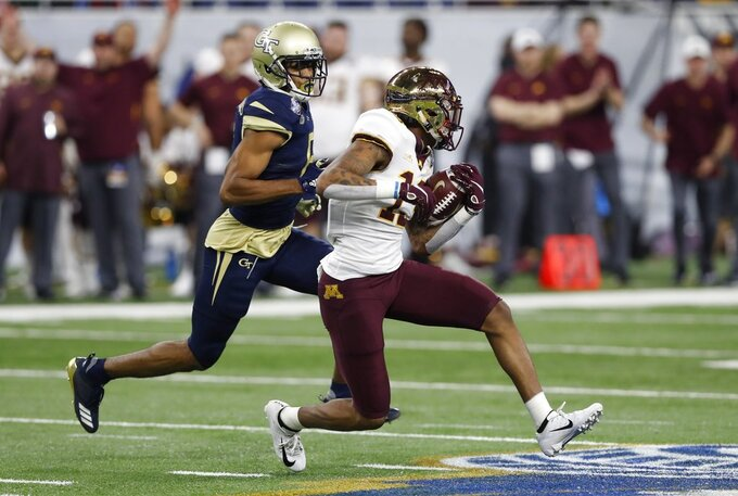 Minnesota wide receiver Rashod Bateman (13) is chased by Georgia Tech defensive back Lamont Simmons (6) during the first half of the Quick Lane Bowl NCAA college football game, Wednesday, Dec. 26, 2018, in Detroit. (AP Photo/Carlos Osorio)